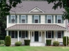 Two Story Home with Rustic Aluminum Metal Shingle Roofing and Standing Seam Metal Roofing