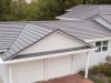 Garage and Home with Rustic Aluminum Metal Shingle Roofing